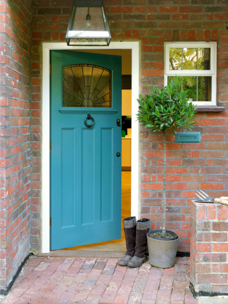 Image via Houzz by CLPM Limited, teal door