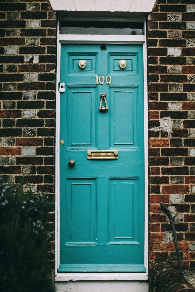 10 Popular Front Door Colors for Brick Houses - Image via Pexels, by Lina Kivaka, teal door