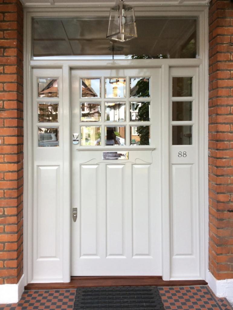 Image via The Bespoke Front Door blog, white door