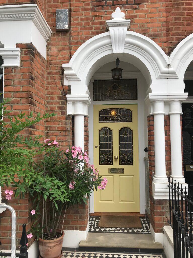 Image via The Bespoke Front Door blog, yellow door