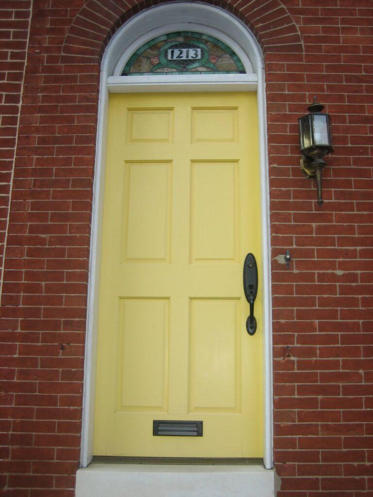 Image via Elizabeth and Co Vintage, yellow door