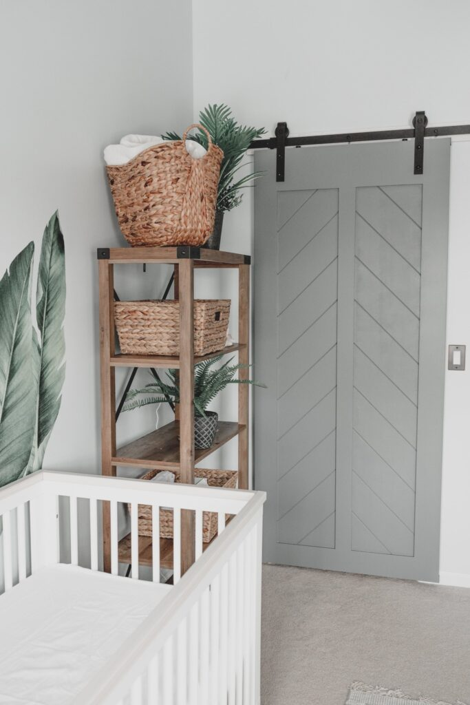 Image via Happily Inspired, feat. Wall color: 'Light Drizzle' by Behr, Barn Door Color: Intergalactic by Behr
