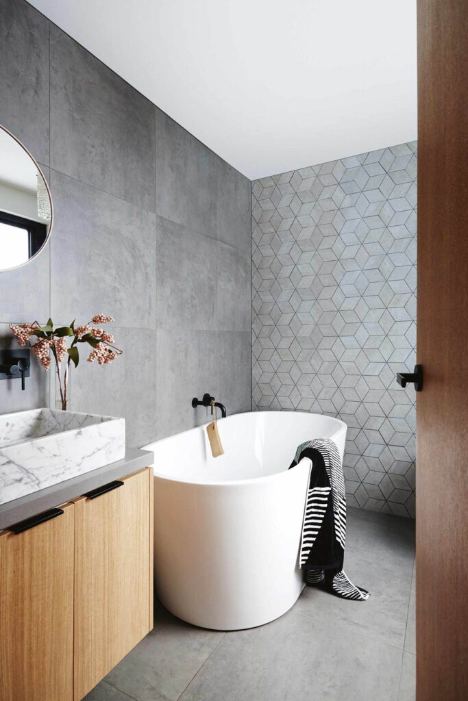 What Color Towels Work Best for Gray Bathrooms? Photo by Armelle Habib via Homes to Love