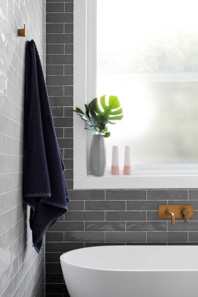 What Color Towels Work Best for Gray Bathrooms? Navy blue accent color, dark gray subway tile, Image by GIA Bathrooms & Kitchens via Houzz