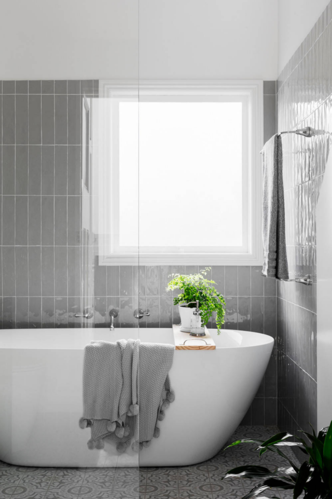 What Color Towels Work Best for Gray Bathrooms? Photo by GIA Bathrooms & Kitchens via Houzz, gray bathroom tiles, vertical subway tile, modern bathroom