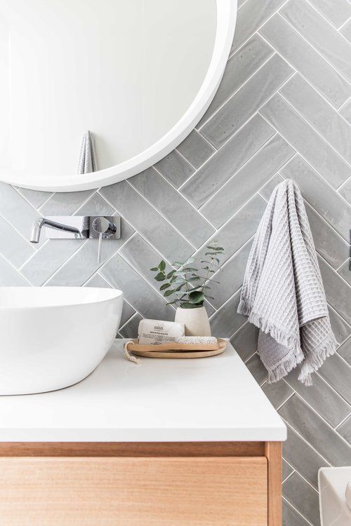 Image via Rock My Style, gray herringbone tile backsplash