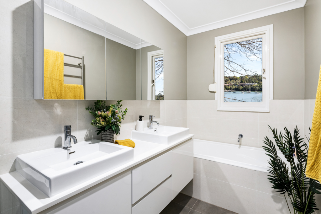 What Color Towels Work Best for Gray Bathrooms? Mustard yellow accent color, Image by Ultima Building Group via Houzz