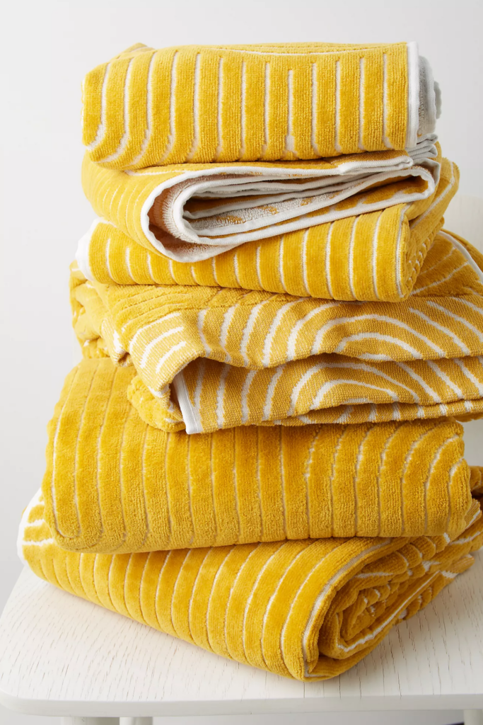 What Color Towels Work Best for Gray Bathrooms? Mustard yellow textured bath towel via Anthropologie