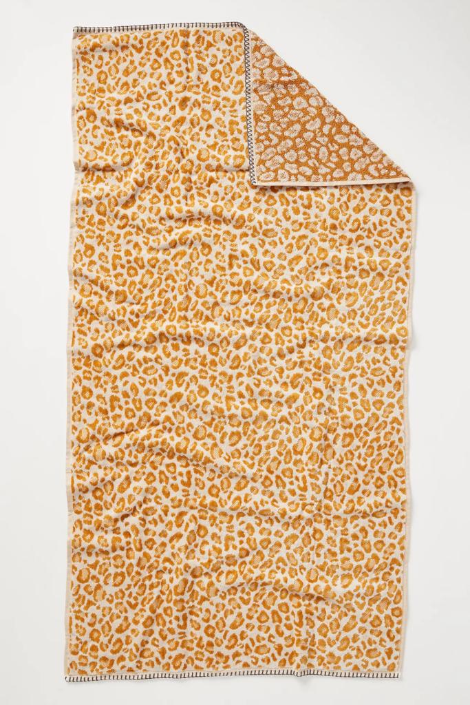 Mustard yellow leopard print bath towel via Anthropologie