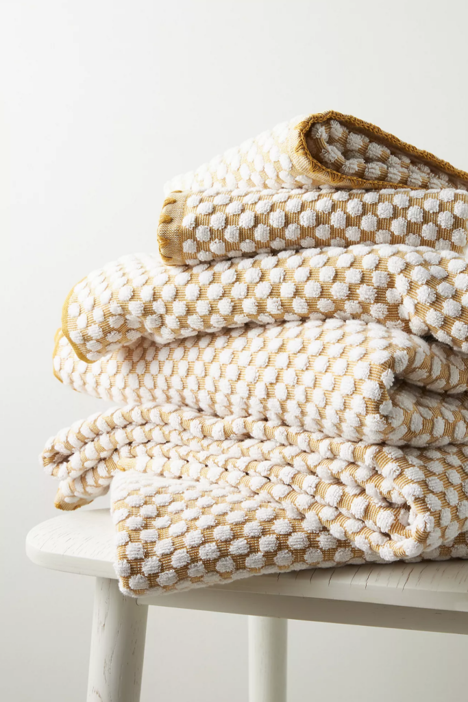 Mustard yellow polka dot bath towel via Anthropologie