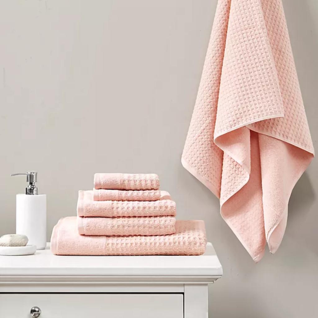 Pink waffle knit bath towels via Bed Bath & Beyond