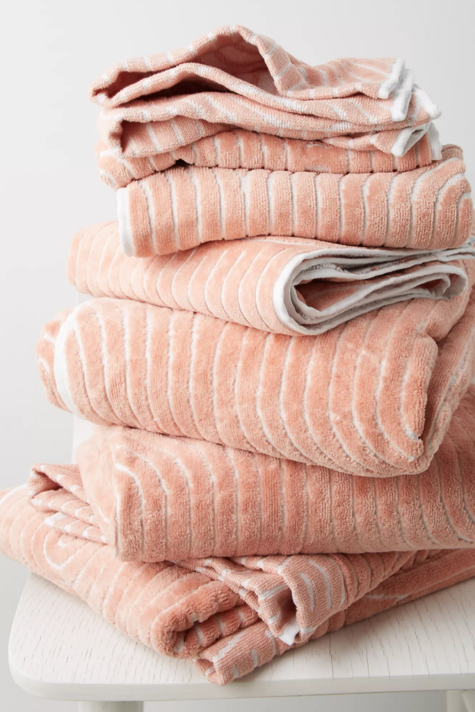 What Color Towels Work Best for Gray Bathrooms? Coral pink textured bath towels via Anthropologie