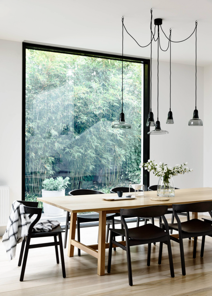 30 Black Wishbone-Inspired Dining Chair Options and Alternatives - Photo by Heather Nette King (Derek Swalwell Styling) via Domain