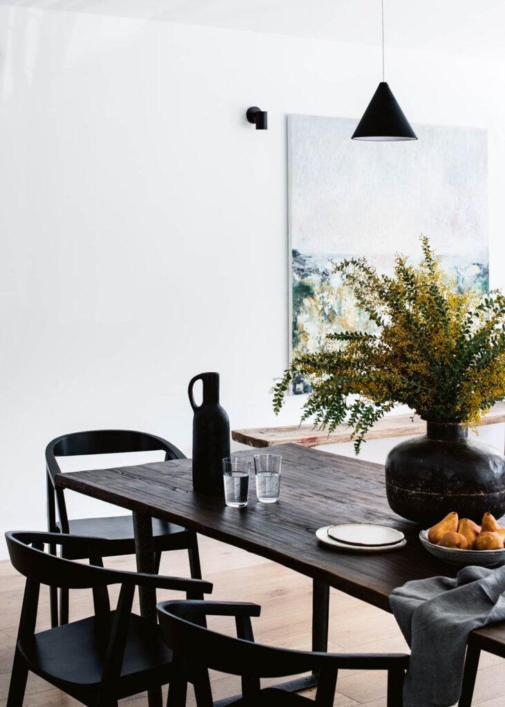 30 Black Wishbone-Inspired Dining Chair Options and Alternatives - Photo by Brigid Arnott via Homes to Love
