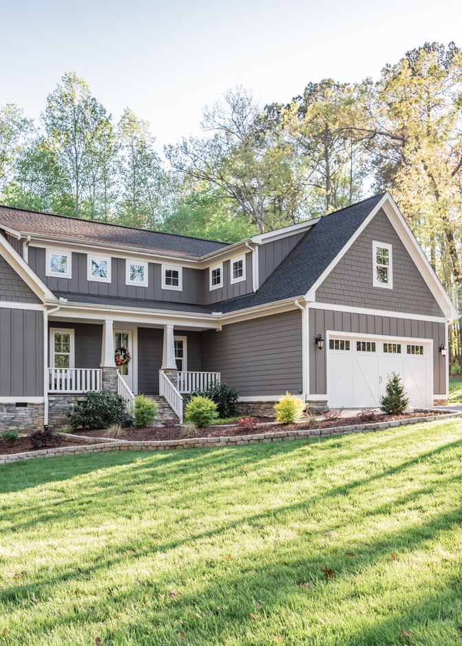 Beautiful Dark Gray Exterior Paint Colors in Action - Image via The Gray Cottage, feat. paint color: 'Gauntlet Gray' by Sherwin Williams