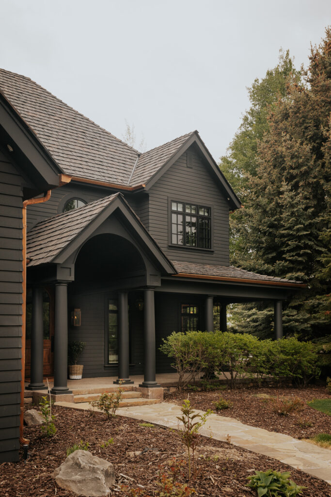 Beautiful Dark Gray Exterior Paint Colors in Action - Image via Chris Loves Julia, feat. paint color: 'Graphite' by Benjamin Moore