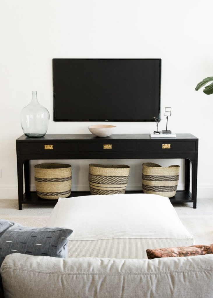 20+ Modern Console Table Ideas for Under Your Wall Mounted TV feat. Photo via Studio McGee