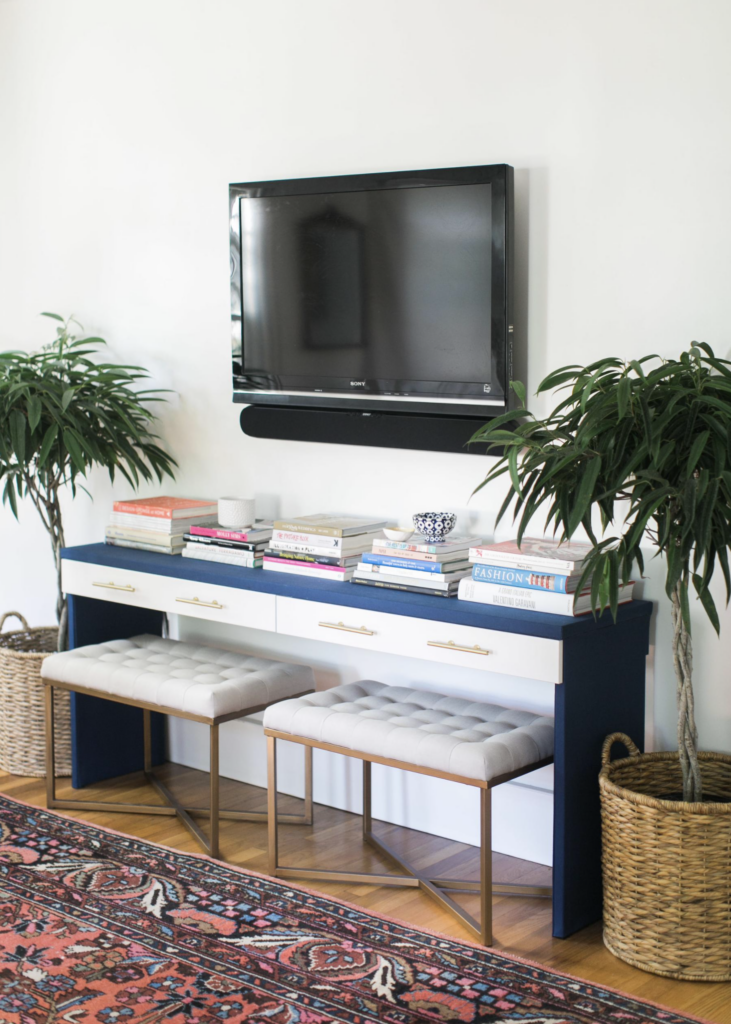 20+ Modern Console Table Ideas for Under Your Wall Mounted TV feat. Photo via Style Me Pretty