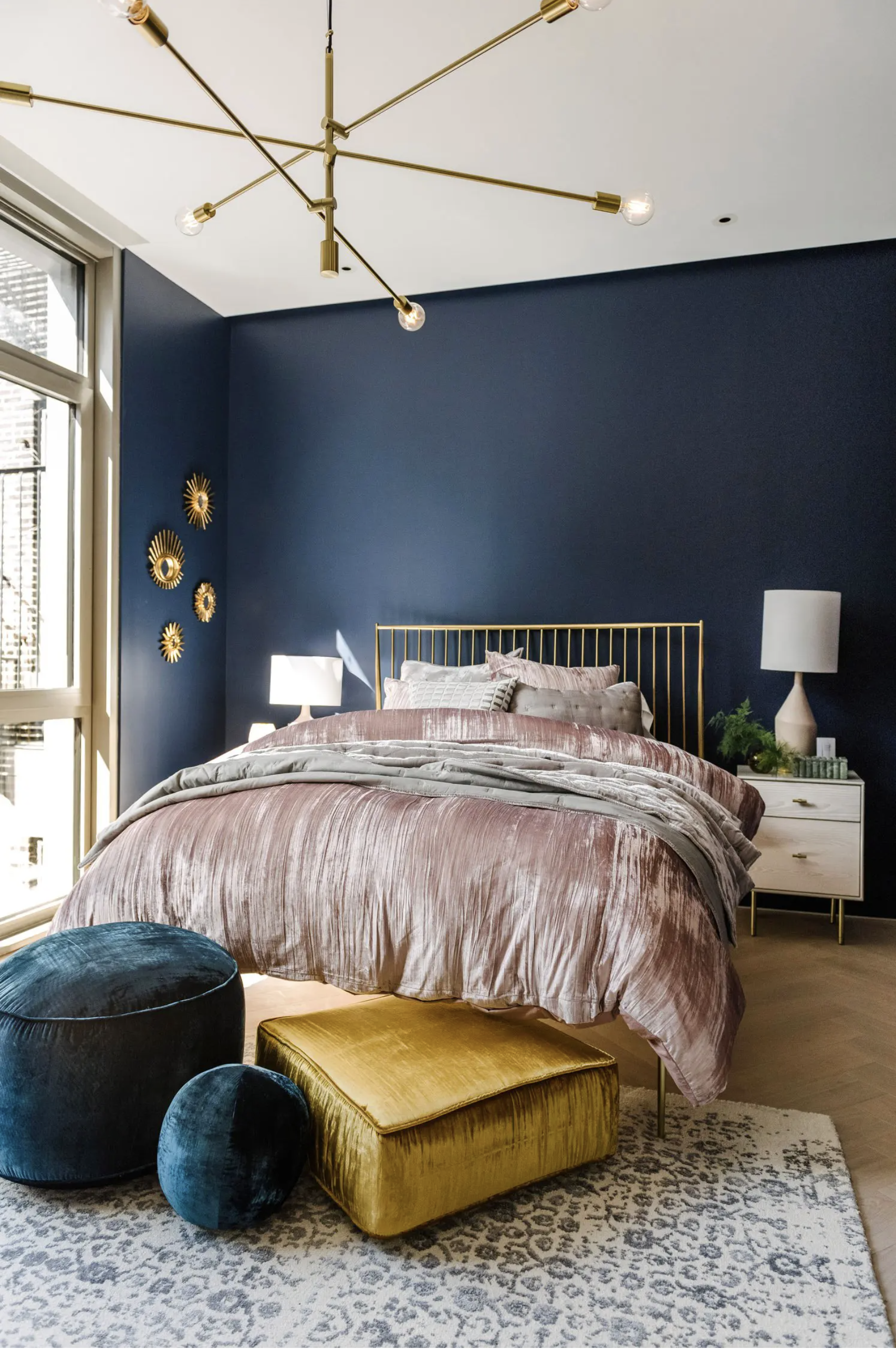 35+ Navy Blue and Gold Bedroom Ideas and Inspiration - Photo by Landon Vonderschmidt via West Elm, feat. paint color 'Naval SW 6244' by Sherwin Williams