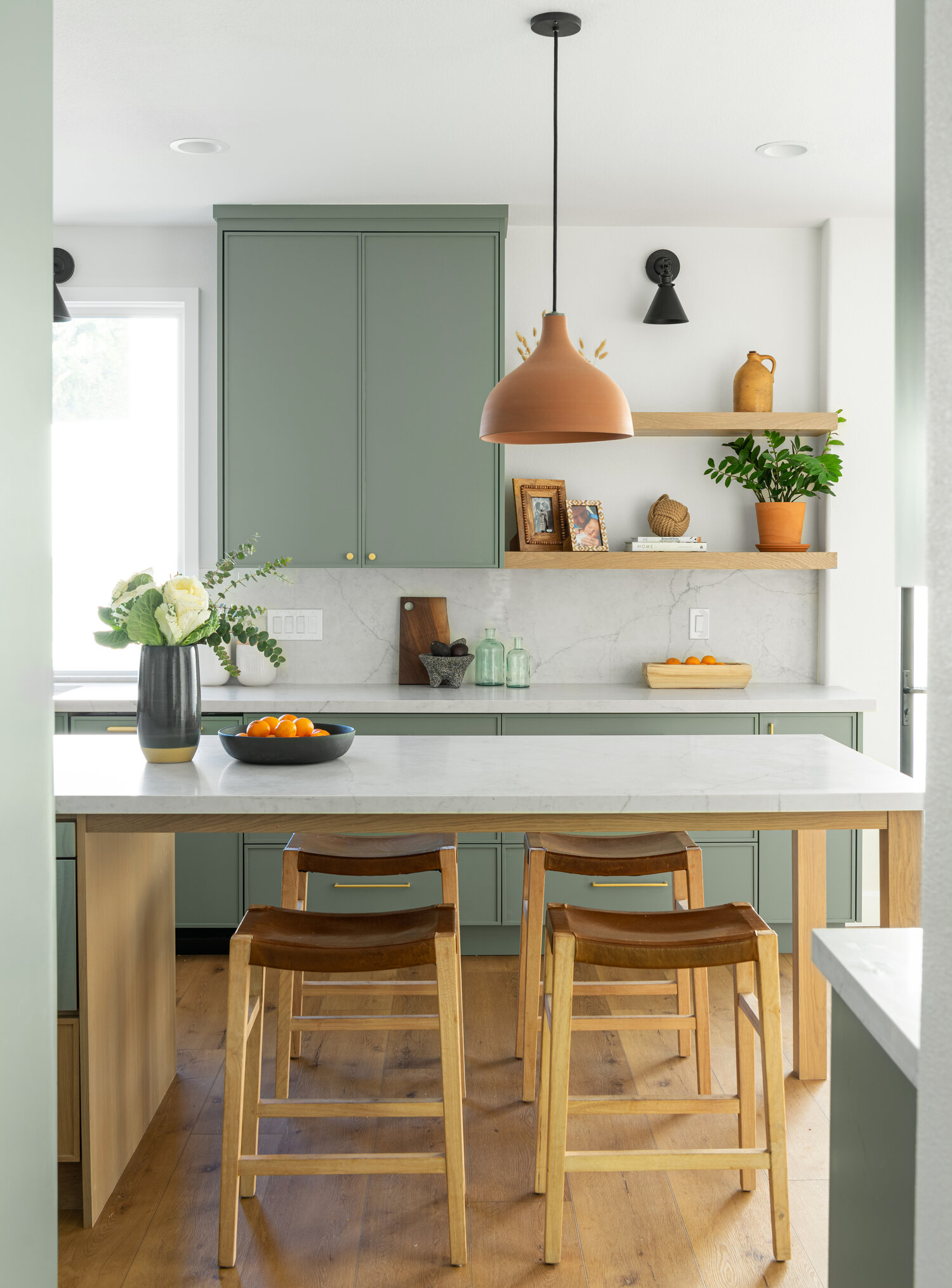 15 Gorgeous Sage Green Kitchen Cabinet Paint Colors in Action - IMAGE: via Well Done feat. paint color 'Retreat' by Sherwin-Williams