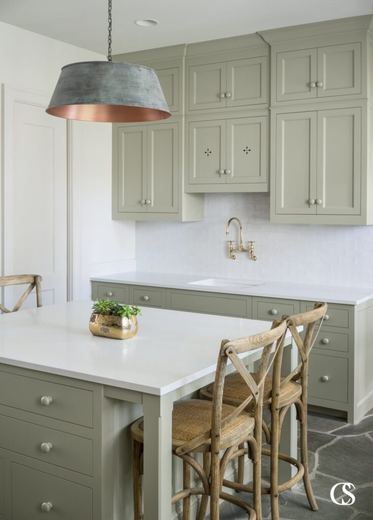 15 Gorgeous Sage Green Kitchen Cabinet Paint Colors in Action - IMAGE: via Christopher Scot Cabinetry Design feat. paint color 'French Gray' by Farrow and Ball