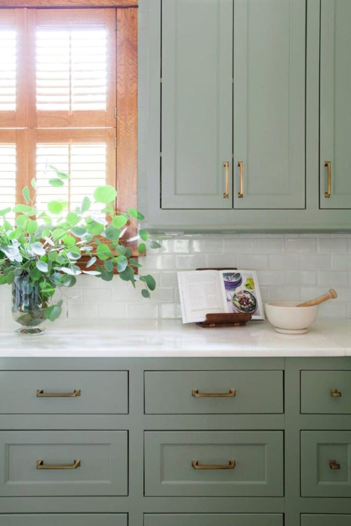 15 Gorgeous Sage Green Kitchen Cabinet Paint Colors in Action - IMAGE: via Room for Tuesday feat. paint color 'Halcyon Green' by Sherwin-Williams