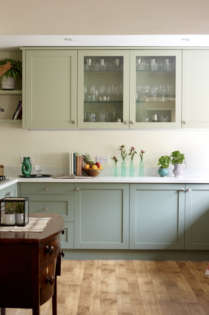 IMAGE: via Abode Carpentry feat. paint color 'Card Room Green' by Farrow and Ball on lower cabinets, and 'Vert de Terre' by Farrow and Ball on upper cabinets