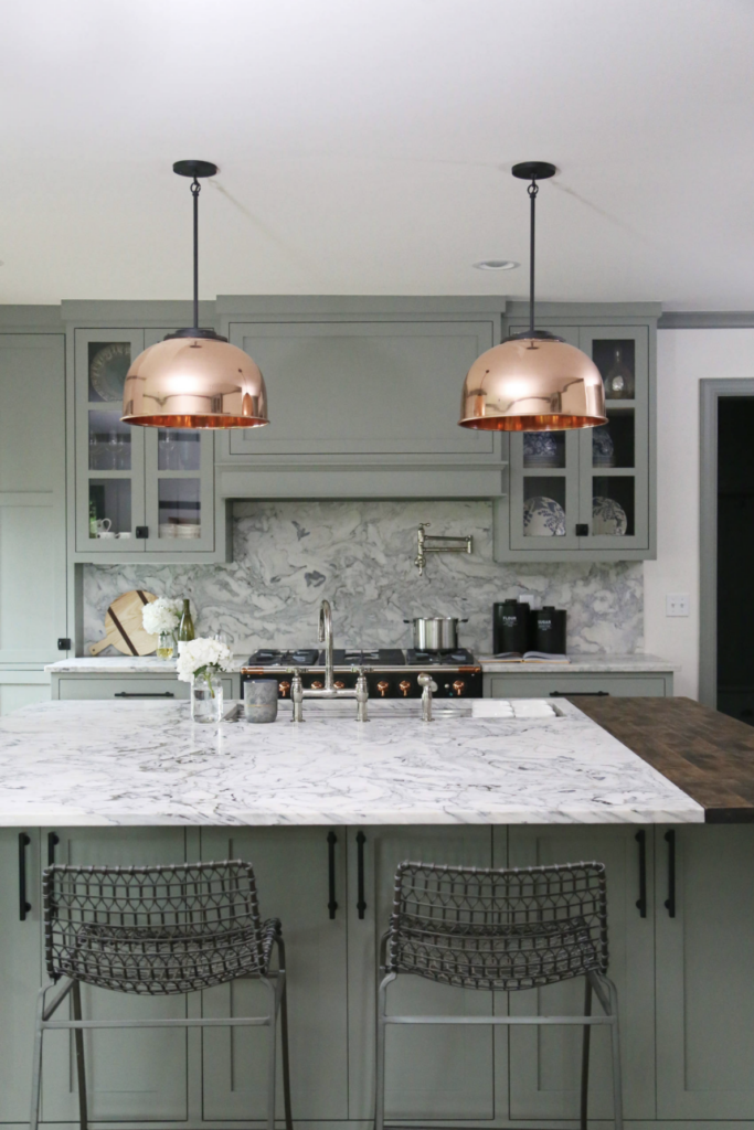 15 Gorgeous Sage Green Kitchen Cabinet Paint Colors in Action - IMAGE: via Woodstock Cabinet Company feat. paint color 'Pigeon' by Farrow and Ball