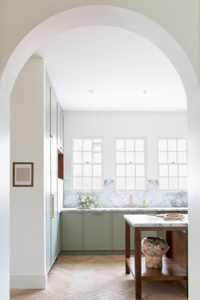 15 Gorgeous Sage Green Kitchen Cabinet Paint Colors in Action - IMAGE: via Regan Baker Design feat. paint color 'Spanish Moss' by C2Paint