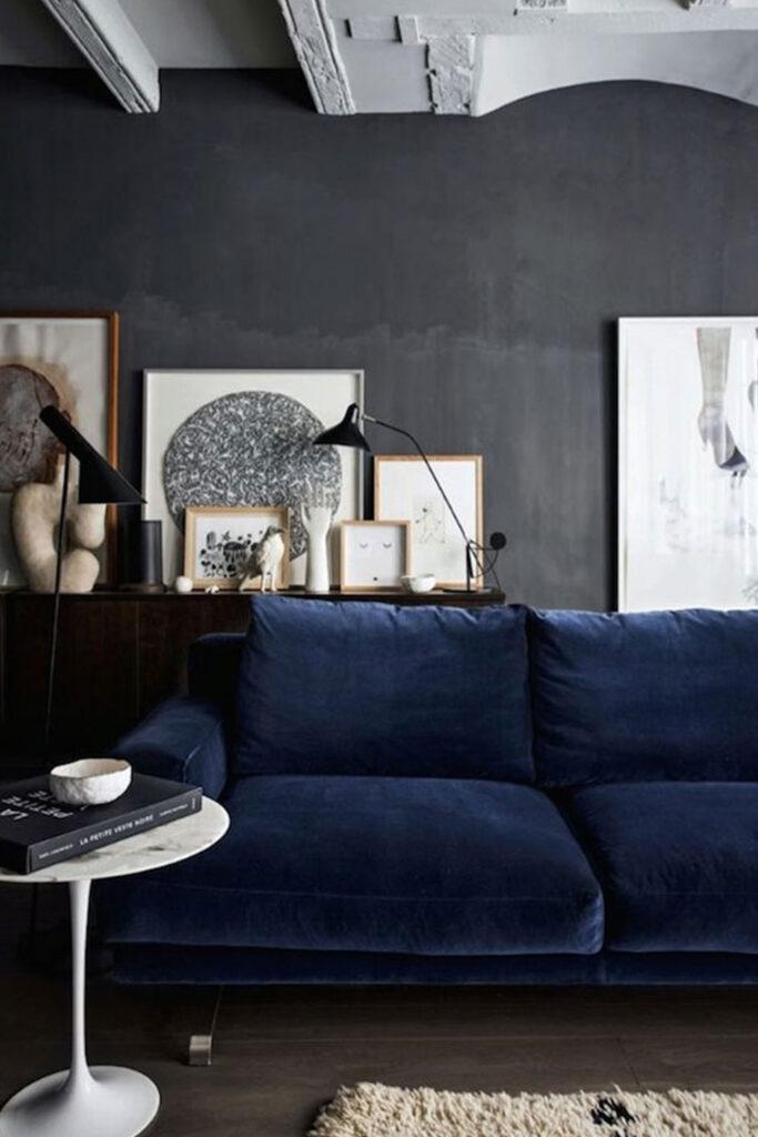 Blue velvet sofa in dark gray living room - Photo by French by Design via Frenchy Fancy