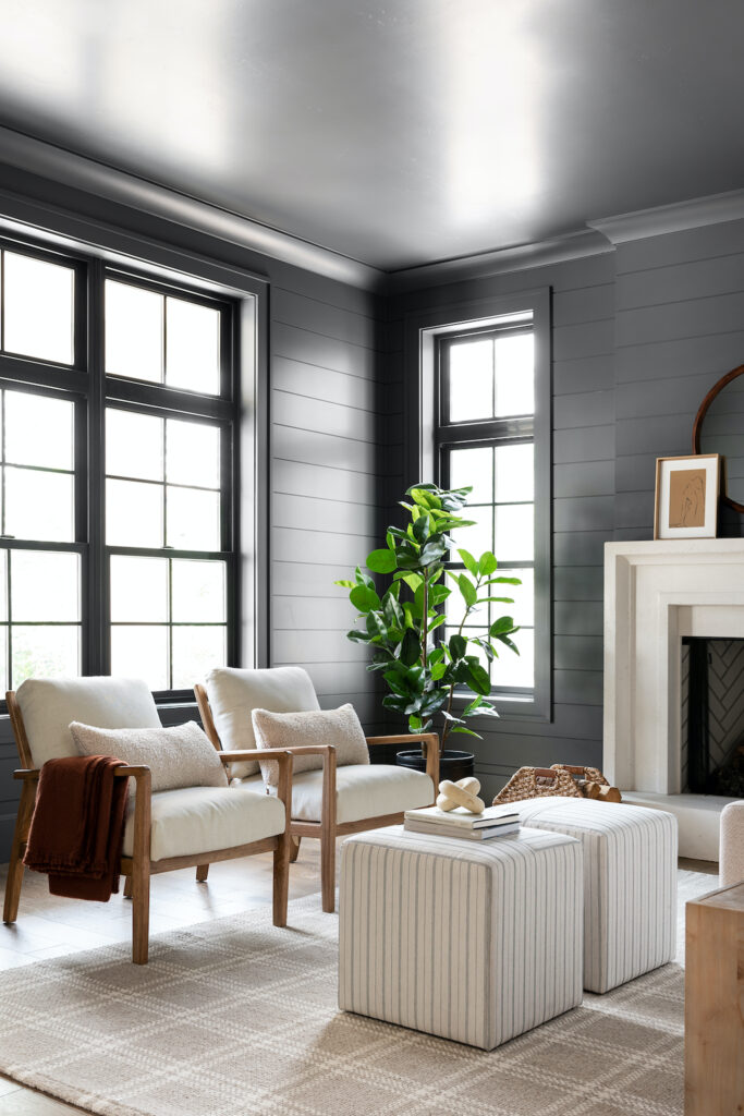 Light neutral living room with charcoal gray walls - Image via Studio McGee