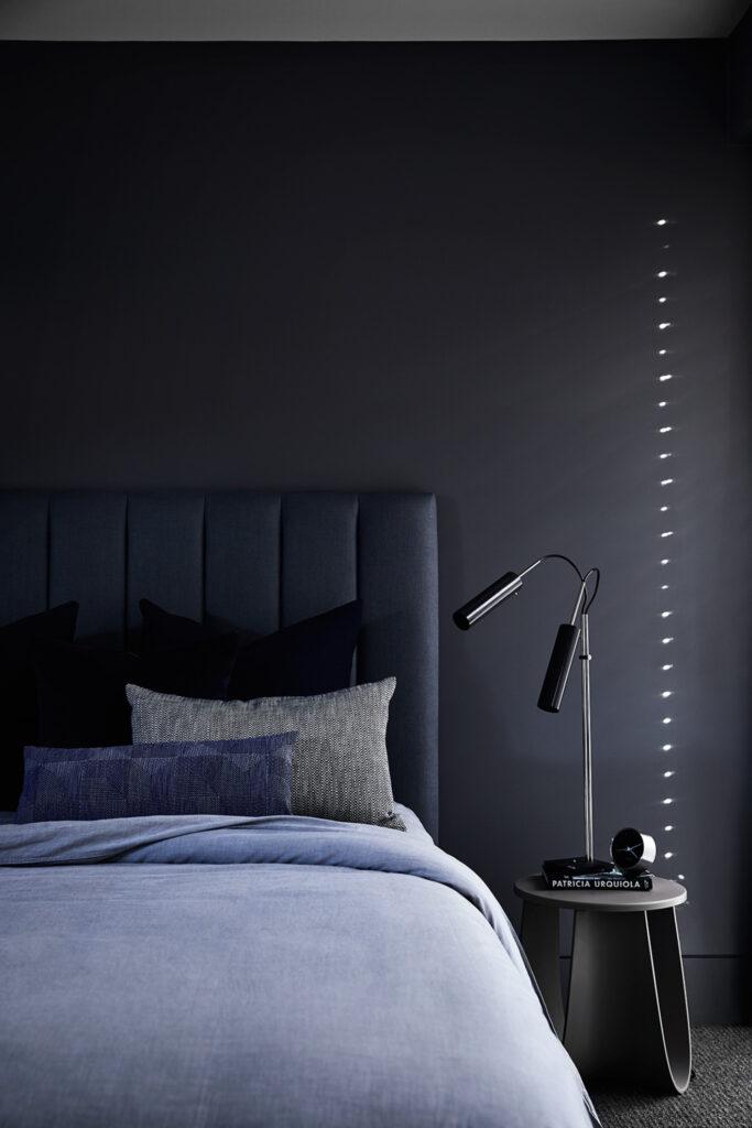 Dark moody blue and gray bedroom - Image via Mim Design